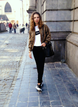 How to wear: black and white athletic shoes, black jeans, white and black print crew-neck t-shirt, brown bomber jacket