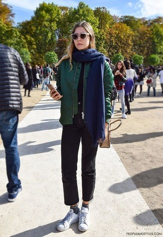 How to wear: white low top sneakers, black jeans, black crew-neck t-shirt, dark green bomber jacket