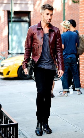 How to wear: black leather chelsea boots, black jeans, charcoal crew-neck t-shirt, burgundy leather bomber jacket