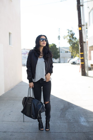 How to wear: black cutout leather ankle boots, black ripped jeans, grey crew-neck t-shirt, black bomber jacket