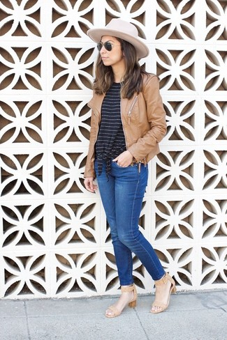 How to wear: tan leather heeled sandals, blue jeans, black and white horizontal striped crew-neck t-shirt, tan leather bomber jacket