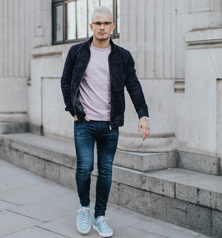 How to wear: light blue suede low top sneakers, navy jeans, pink crew-neck t-shirt, black suede bomber jacket