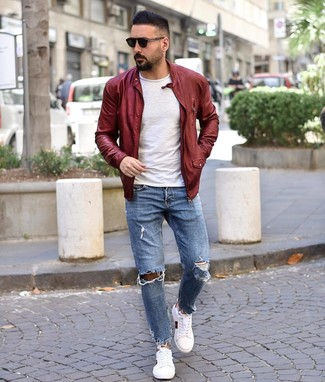 How to wear: white print low top sneakers, light blue ripped jeans, white crew-neck t-shirt, burgundy leather bomber jacket