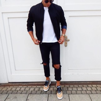 How to wear: tan low top sneakers, black ripped jeans, white crew-neck t-shirt, black bomber jacket