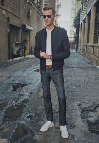 How to Wear a Brown Leather Watch For Men: Definitive proof that a navy bomber jacket and a brown leather watch are amazing together in an off-duty look. If you need to effortlesslly elevate your ensemble with shoes, why not introduce a pair of white leather low top sneakers to the mix?