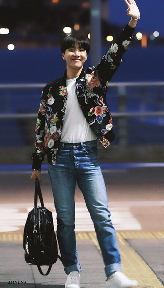 Men's Looks & Outfits: What To Wear In Warm Weather: If you're on the lookout for a relaxed casual but also sharp outfit, try pairing a black floral bomber jacket with blue jeans. Our favorite of an infinite number of ways to finish this getup is with white low top sneakers.