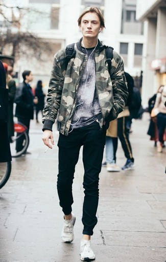 How to Wear an Olive Camouflage Bomber Jacket For Men: This off-duty combo of an olive camouflage bomber jacket and black jeans is extremely easy to throw together without a second thought, helping you look sharp and prepared for anything without spending too much time searching through your wardrobe. Why not add a pair of white athletic shoes to the equation for a more casual twist?