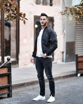 How to Wear a Black Bomber Jacket For Men: This casual combo of a black bomber jacket and charcoal jeans is perfect when you need to look laid-back and cool but have zero time to put together an outfit. A pair of white canvas low top sneakers serves as the glue that brings this ensemble together.