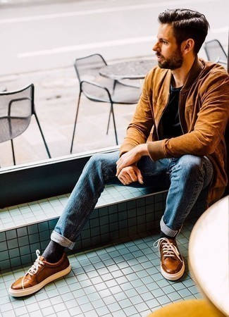 How to Wear a Tobacco Suede Bomber Jacket For Men: Fashionable and functional, this laid-back pairing of a tobacco suede bomber jacket and blue jeans provides with variety. Complement your ensemble with a pair of tobacco leather low top sneakers and you're all done and looking dashing.