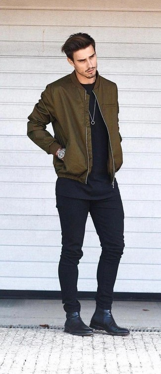 How to Wear Shoes For Men: This pairing of an olive bomber jacket and black jeans is on the off-duty side yet it's also seriously stylish and truly dapper. Finishing off with a pair of black leather chelsea boots is a fail-safe way to introduce some extra zing to your getup.