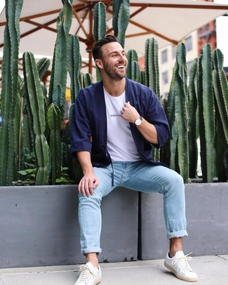 How to wear: white leather low top sneakers, light blue jeans, white crew-neck t-shirt, navy cardigan