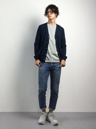 Teen Boy Fashion: What To Wear: A navy cardigan and blue jeans are among the fundamental pieces in any modern gentleman's great casual collection. Grey athletic shoes are guaranteed to give a touch of stylish casualness to this look. If you're wondering what you should wear as a teen, this combo is a good source of inspiration.