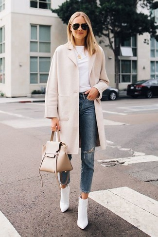How to wear: white leather ankle boots, blue ripped jeans, white crew-neck t-shirt, beige coat