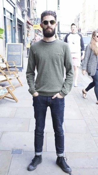 Men's Looks & Outfits: What To Wear In 2020: For a relaxed ensemble, pair an olive crew-neck sweater with navy jeans — these pieces go beautifully together. Complement your ensemble with black canvas high top sneakers to change things up a bit.