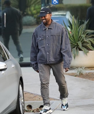 How to wear: white athletic shoes, grey jeans, brown crew-neck t-shirt, grey denim jacket