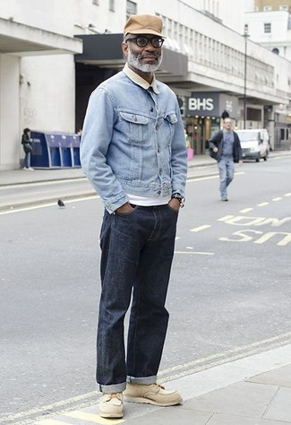How to wear: beige leather work boots, navy jeans, white crew-neck t-shirt, light blue denim jacket