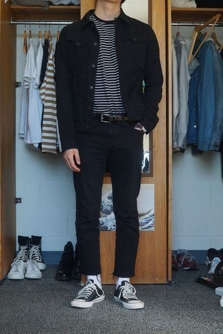 How to Wear Black and White Canvas Low Top Sneakers For Men: This casual combination of a black denim jacket and black jeans is a fail-safe option when you need to look cool and relaxed but have zero time. The whole ensemble comes together when you add black and white canvas low top sneakers to the equation.
