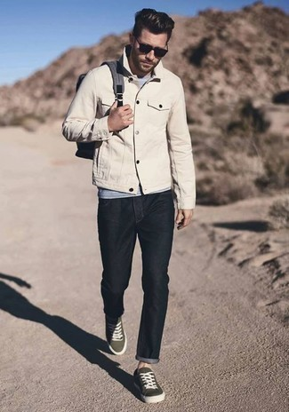 How to Wear Black Jeans For Men: You'll be amazed at how very easy it is for any guy to get dressed like this. Just a beige denim jacket and black jeans. A pair of olive canvas low top sneakers is a wonderful choice to round off this outfit.