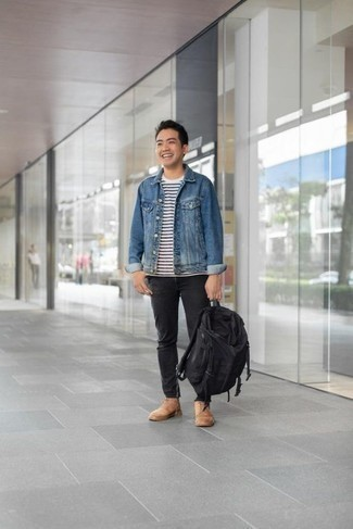 How to Wear a Blue Denim Jacket For Men: A blue denim jacket and black jeans are the kind of a no-brainer off-duty combo that you need when you have zero time to put together an outfit. Our favorite of a variety of ways to finish this outfit is with tan suede casual boots.