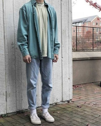 How to Wear a Light Blue Denim Shirt For Men: For an ensemble that's super straightforward but can be styled in plenty of different ways, marry a light blue denim shirt with light blue jeans. A pair of white canvas low top sneakers finishes off this ensemble very nicely.
