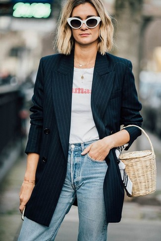 How to wear: beige straw handbag, light blue jeans, white and red print crew-neck t-shirt, black vertical striped double breasted blazer