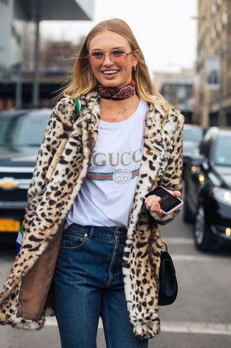 How to wear: black leather crossbody bag, navy jeans, white print crew-neck t-shirt, tan leopard fur coat