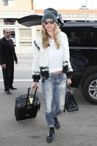 How to wear: black leather low top sneakers, blue jeans, white crew-neck t-shirt, white fur jacket