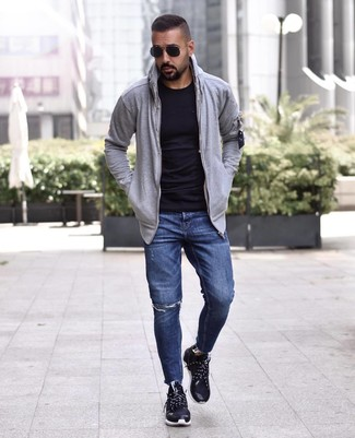 How to wear: black athletic shoes, navy ripped jeans, black crew-neck t-shirt, grey hoodie