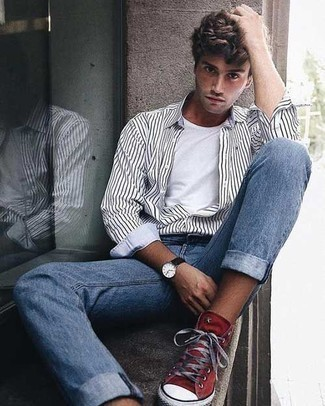 Men's Looks & Outfits: What To Wear In 2020: Reach for a white and black vertical striped long sleeve shirt and light blue jeans for both dapper and easy-to-create ensemble. And if you want to easily tone down your ensemble with shoes, add a pair of red canvas high top sneakers to the equation.