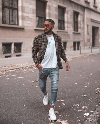 How to Wear a Brown Leather Bracelet For Men: Opt for a black plaid long sleeve shirt and a brown leather bracelet to achieve an incredibly stylish and edgy ensemble. You know how to dress it up: white canvas low top sneakers.