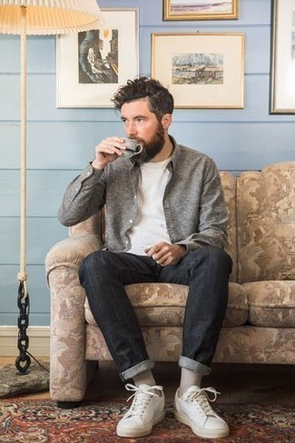 How to Wear White Leather Low Top Sneakers For Men: A grey long sleeve shirt and charcoal jeans are a savvy pairing to keep in your off-duty lineup. When it comes to shoes, introduce white leather low top sneakers to this ensemble.
