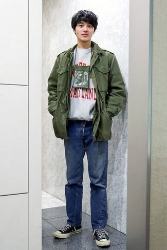 Men's Looks & Outfits: What To Wear In 2020: This combo of an olive military jacket and blue jeans is super easy to assemble and so comfortable to wear a variation of from dawn till dusk as well! Feeling creative? Dial down this outfit by finishing with navy and white canvas low top sneakers.
