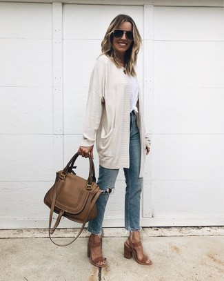 How to wear: brown suede heeled sandals, blue ripped jeans, white crew-neck t-shirt, beige open cardigan