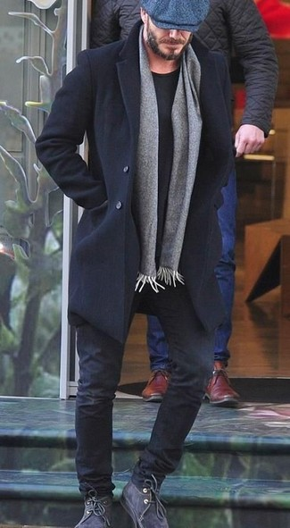 How to wear: charcoal suede desert boots, black jeans, black crew-neck t-shirt, black overcoat