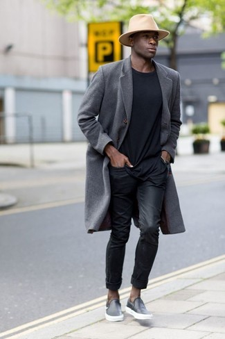 How to wear: black leather slip-on sneakers, black jeans, black crew-neck t-shirt, grey overcoat