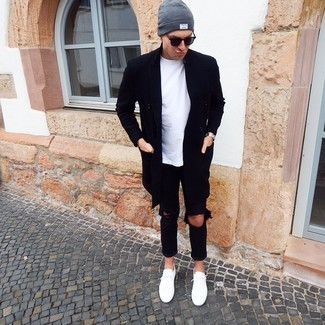 How to wear: white low top sneakers, black ripped jeans, white crew-neck t-shirt, black overcoat