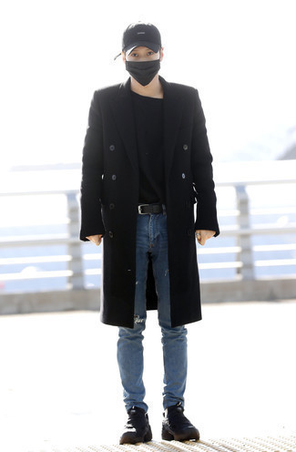 Men's Looks & Outfits: What To Wear In a Relaxed Way: Consider teaming a black overcoat with blue ripped jeans to feel fully confident and look casually cool. Want to dial it down with shoes? Add a pair of black canvas work boots to your ensemble for the day.
