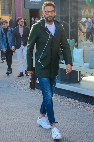 Men's Looks & Outfits: What To Wear In Cold Weather: If you're in search of a laid-back and at the same time stylish look, go for a dark green overcoat and blue ripped jeans. Let your styling credentials truly shine by finishing off this getup with white leather low top sneakers.