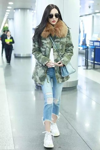 How to wear: white athletic shoes, light blue ripped jeans, white and black print crew-neck t-shirt, olive camouflage parka