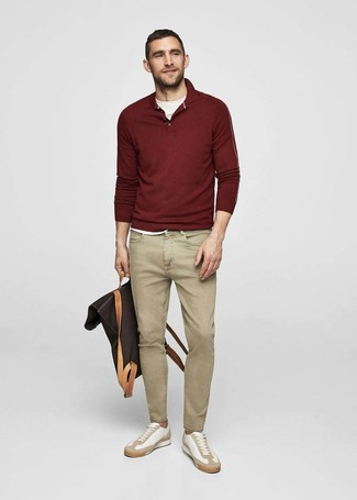 How to wear: white leather low top sneakers, khaki jeans, white crew-neck t-shirt, burgundy polo neck sweater