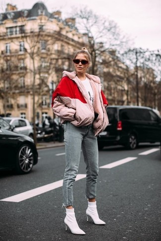 How to wear: white elastic ankle boots, grey jeans, white and black print crew-neck t-shirt, pink puffer jacket