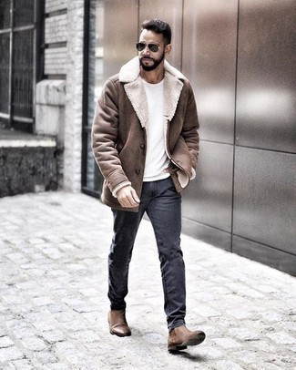 How to Wear a Brown Shearling Jacket For Men: This is solid proof that a brown shearling jacket and charcoal jeans are awesome when paired together in a relaxed getup. Here's how to inject a hint of elegance into this outfit: brown leather chelsea boots.