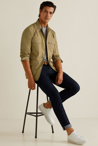 How to wear: white canvas low top sneakers, navy jeans, grey crew-neck t-shirt, olive shirt jacket
