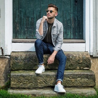 How to wear: white low top sneakers, navy jeans, olive crew-neck t-shirt, light blue vertical striped shirt jacket