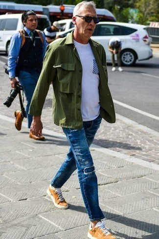 How to Wear an Olive Shirt Jacket For Men: Pair an olive shirt jacket with blue patchwork jeans to put together a daily ensemble that's full of charisma and personality. You can get a little creative on the shoe front and complete this outfit with a pair of tobacco canvas low top sneakers.