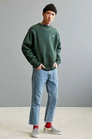 Men's Looks & Outfits: What To Wear In 2020: This combination of a dark green sweatshirt and light blue jeans is proof that a pared down off-duty getup can still be really interesting. When it comes to footwear, this outfit is complemented wonderfully with black and white check canvas slip-on sneakers.