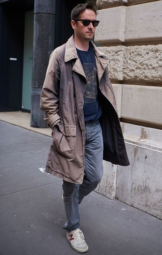 How to Wear Grey Canvas Low Top Sneakers For Men: A brown trenchcoat and grey jeans are the kind of a fail-safe combination that you need when you have no time to spare. Complement this ensemble with a pair of grey canvas low top sneakers to change things up a bit.