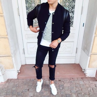 How to Wear a Black Varsity Jacket For Men: If you're searching for an edgy but also seriously stylish outfit, pair a black varsity jacket with black ripped jeans. If you wish to immediately kick up this outfit with shoes, add a pair of white low top sneakers to the mix.