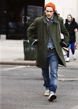 How to wear: white slip-on sneakers, blue jeans, blue denim jacket, olive overcoat