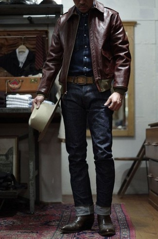 Which Denim Shirt To Wear With a Leather Jacket For Men: This pairing of a leather jacket and a denim shirt speaks casual cool and stylish functionality. To introduce a little flair to this look, introduce a pair of dark brown leather chelsea boots to the equation.